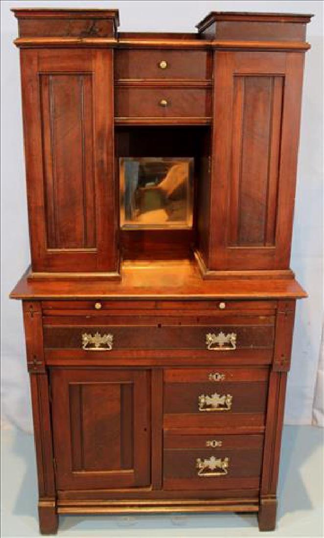Walnut Victorian dental cabinet with brass pulls