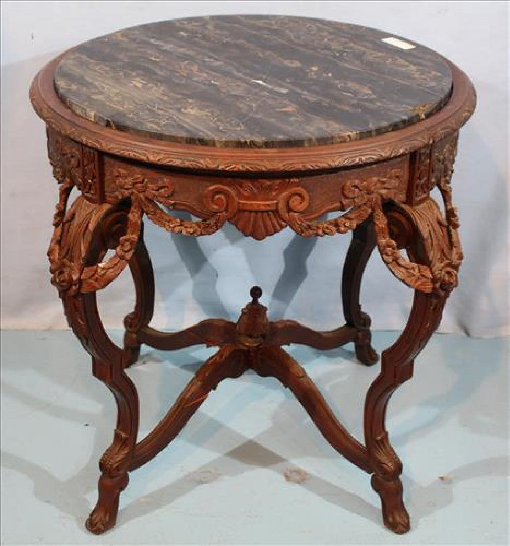 Mahogany heavily carved center table with inserted