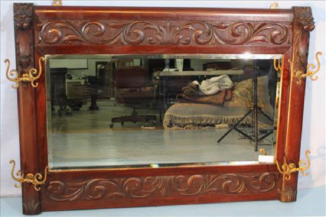 Mahogany heavily carved hanging mirror with lion heads