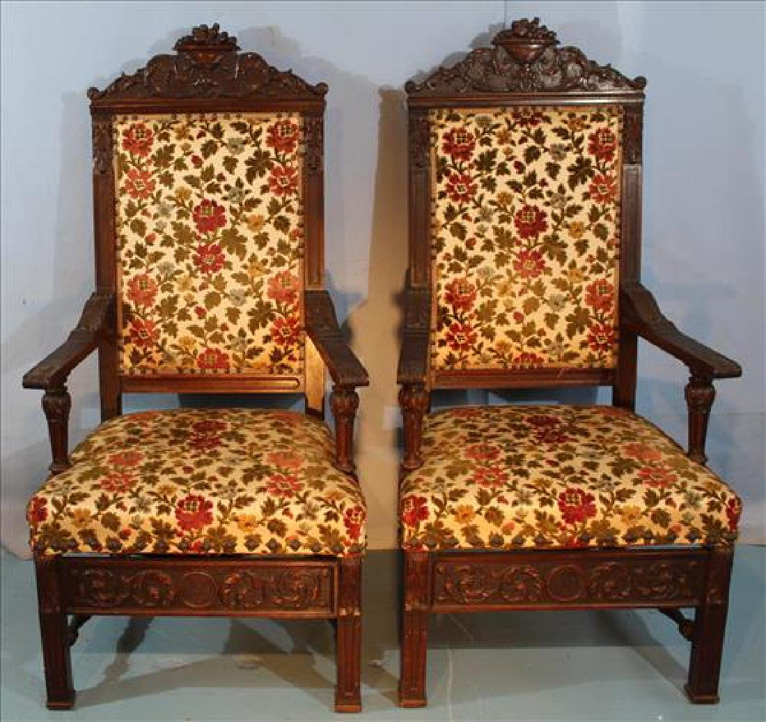 Pair of mahogany heavily carved arm chairs