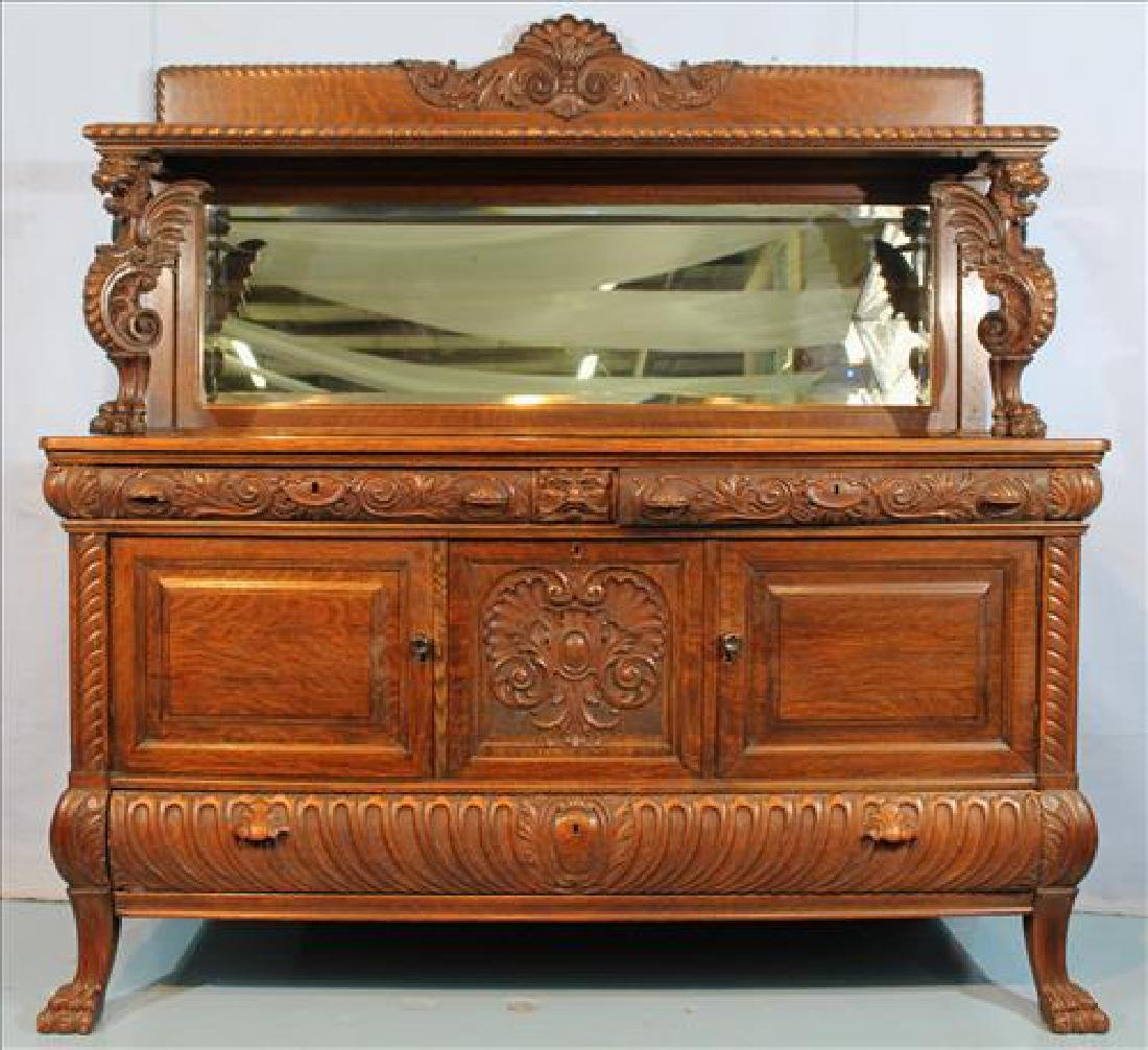 Solid oak carved sideboard with winged Griffin Supports