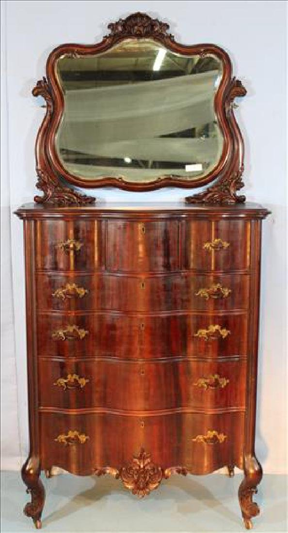 Mahogany highboy chest with bevel mirror and carved