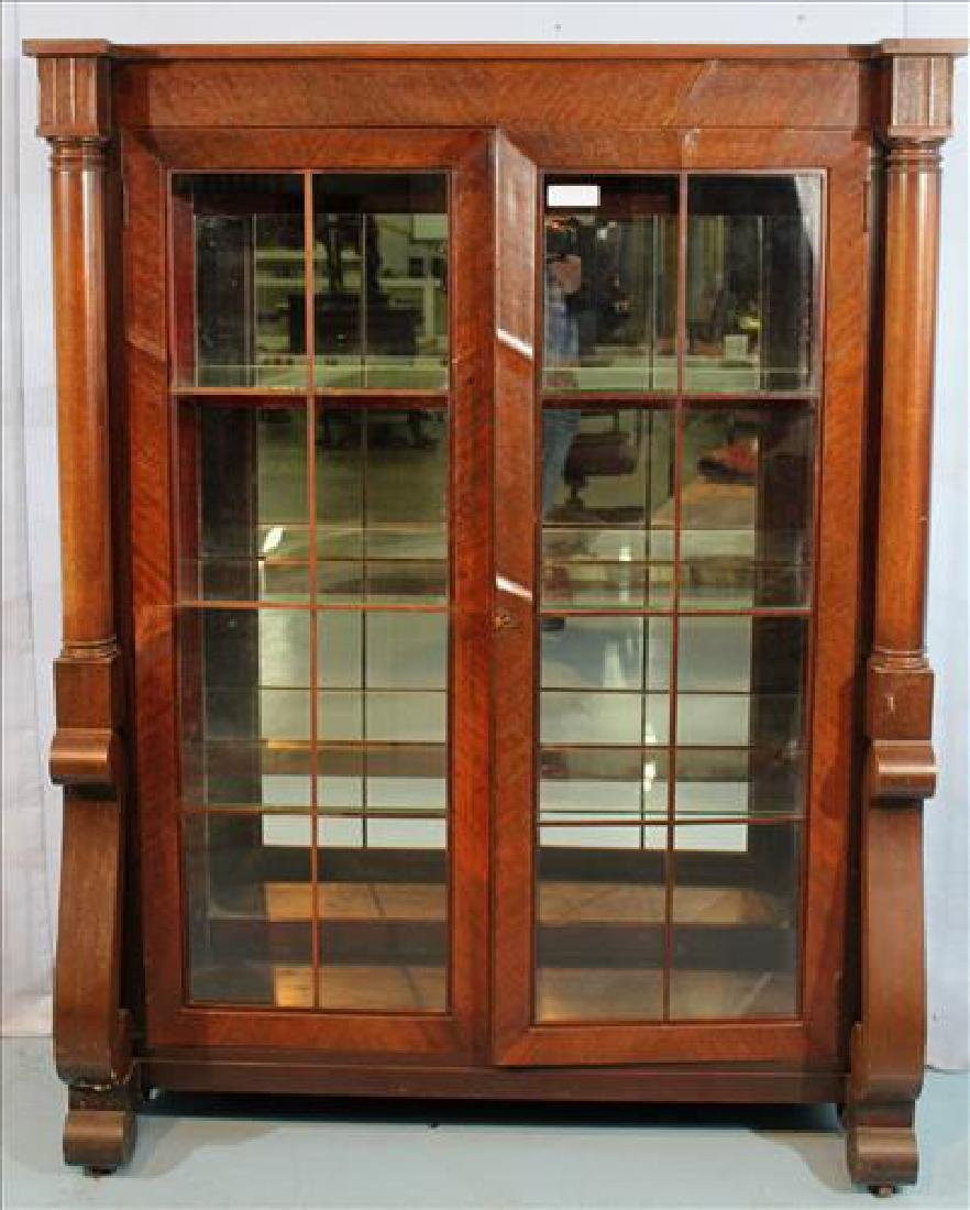 Mahogany Empire china cabinet with column and scroll