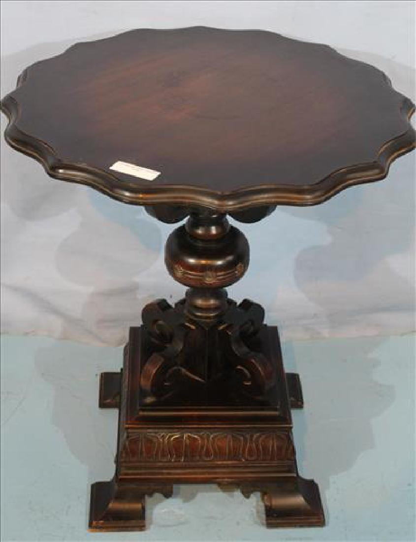 Unusual mahogany center table with carved base