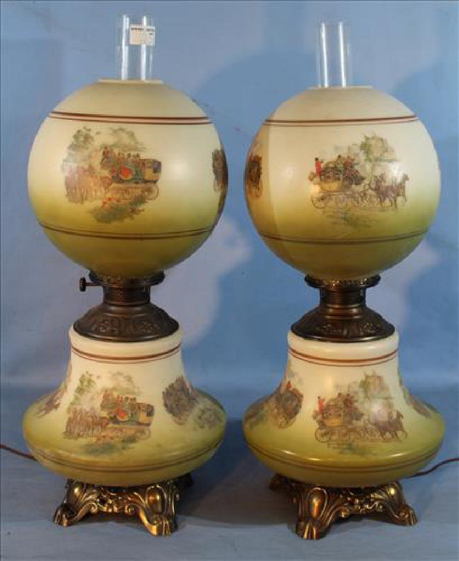 Pair Victorian oil lamps with stagecoach, 29 in. T.