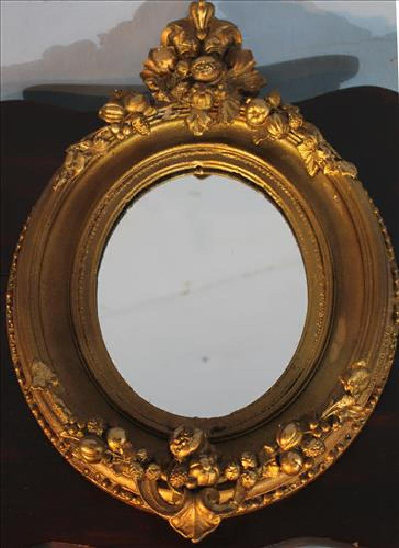 Small gold gilded mirror, 16 in. T, 11 in. W.