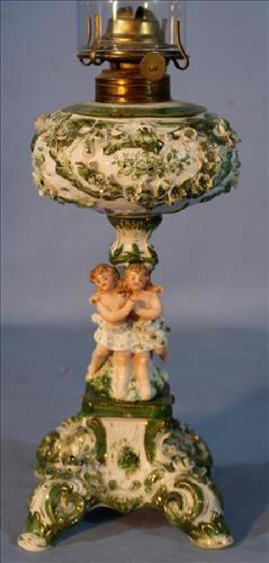 Meissen figural oil lamp with figure of boy and girl