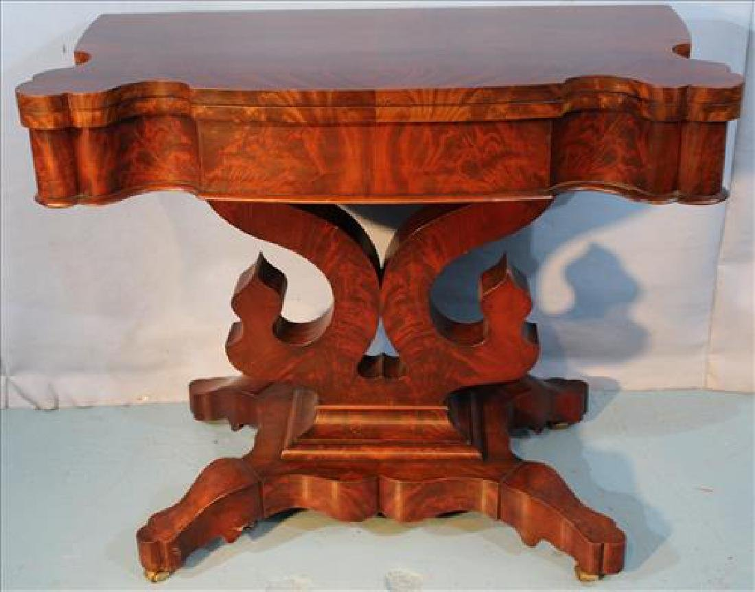 Very clean Empire game table with serpentine skirt
