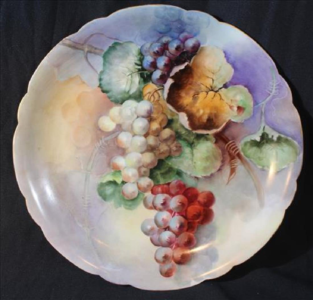 Hand painted Limoges charger with grapes, 13 in. Dia.