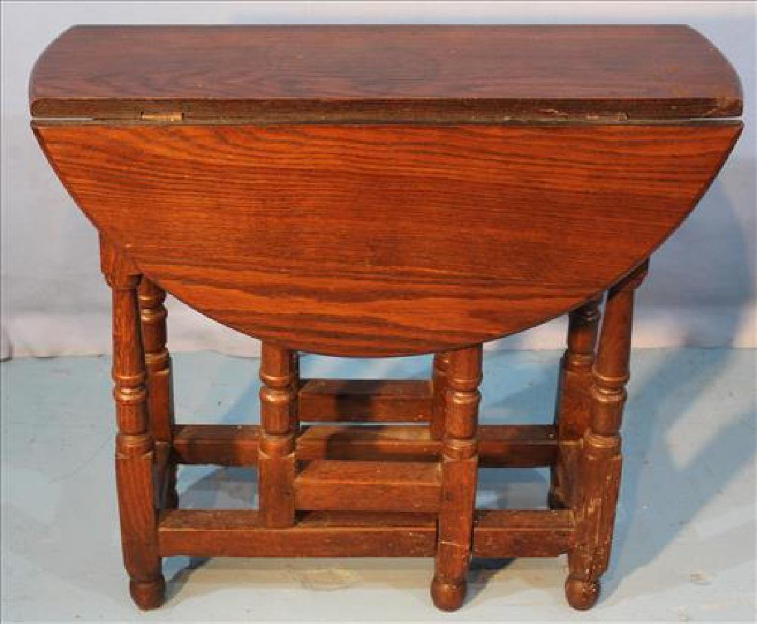 Small oak gate leg table with original finish