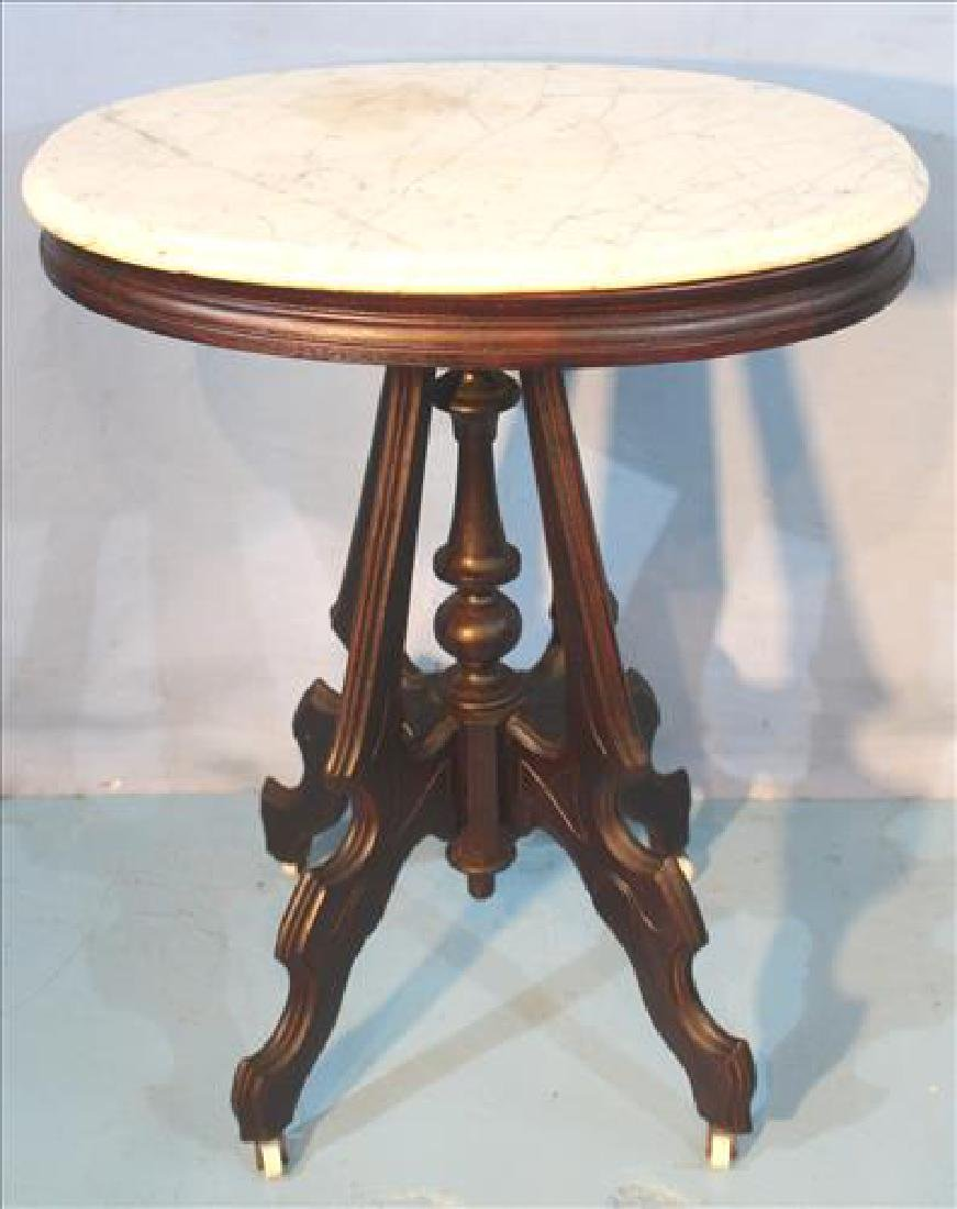 Small Victorian walnut oval table, all original