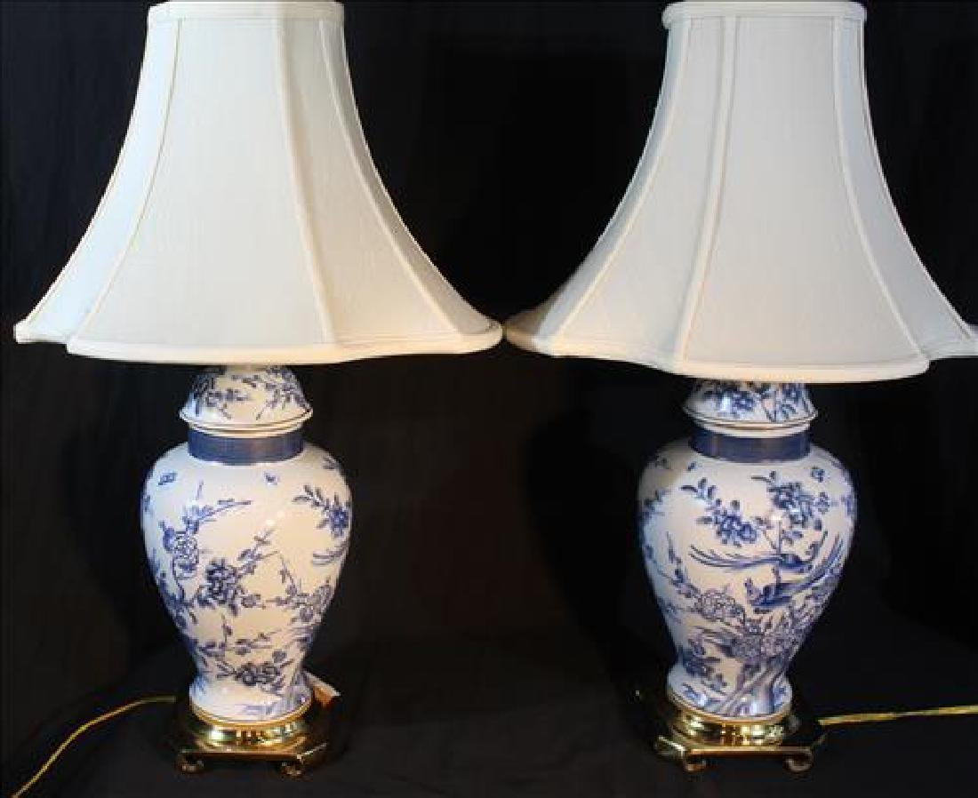 Pair of oriental style blue and white urns as lamps