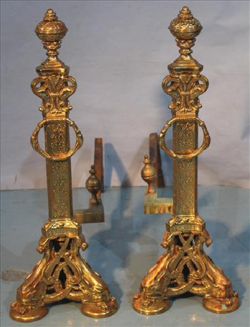 Pair of ornate brass andirons w griffin supports