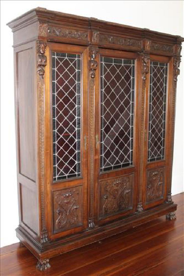 Oak heavily carved 3 door bookcase with glass doors