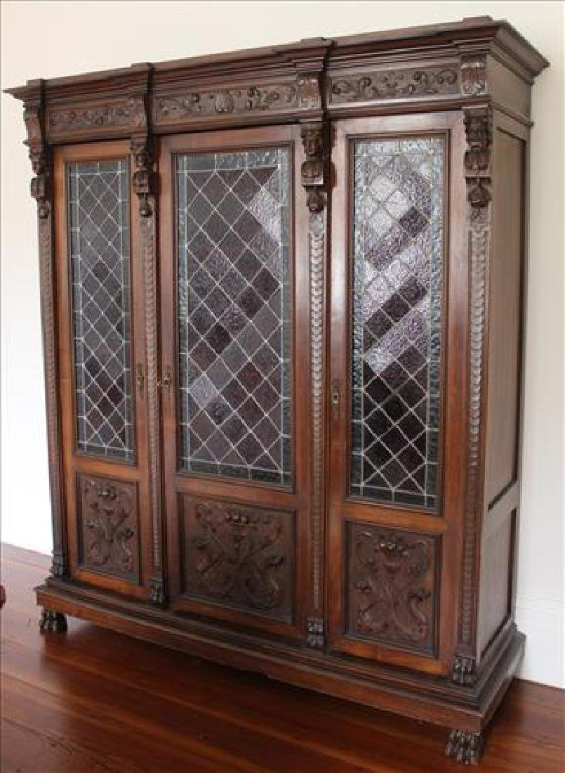 Oak heavily carved 3 door bookcase with glass doors - 2