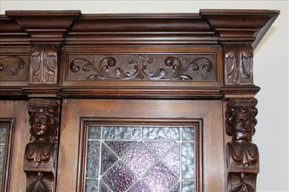 Oak heavily carved 3 door bookcase with glass doors - 3
