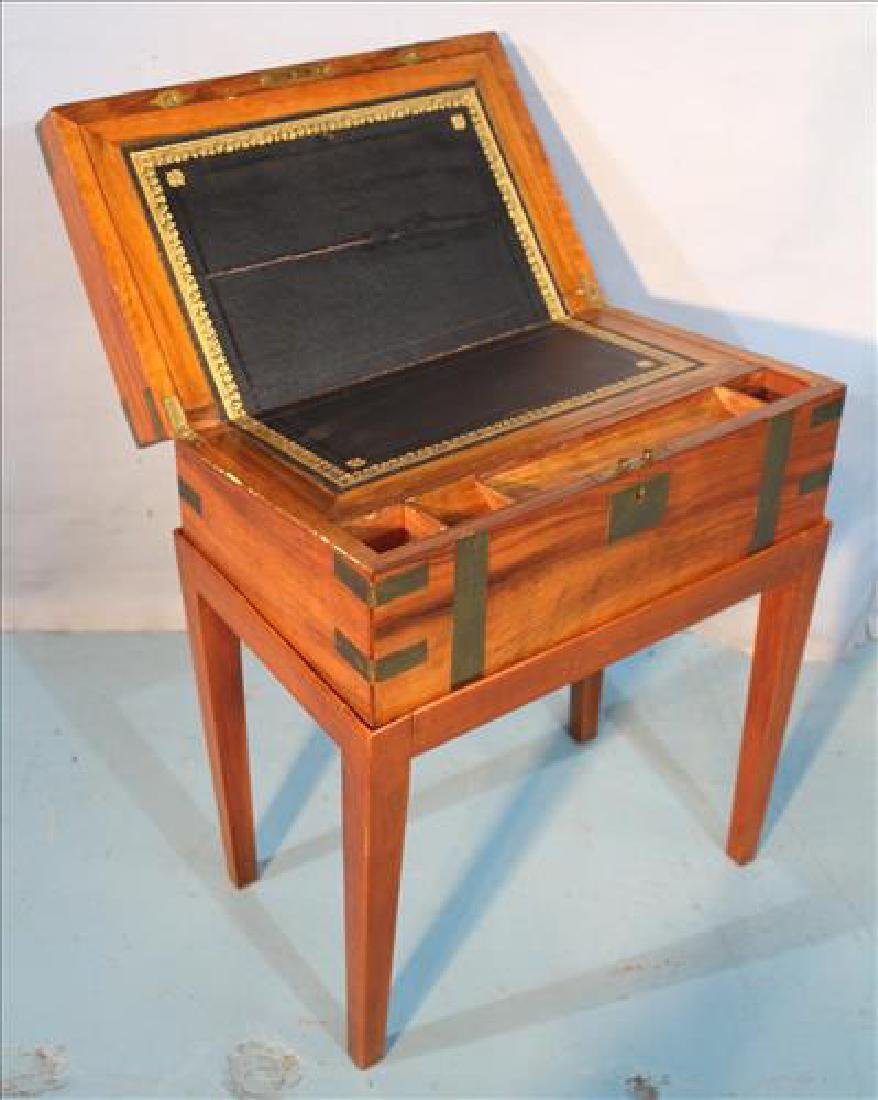 Mahogany lap desk on fitted stand