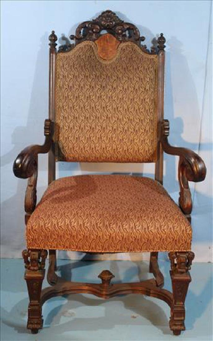 Mahogany heavily carved arm fireside chair