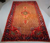 Handmade wool Persian rug, red and blue, 5 x 9.1
