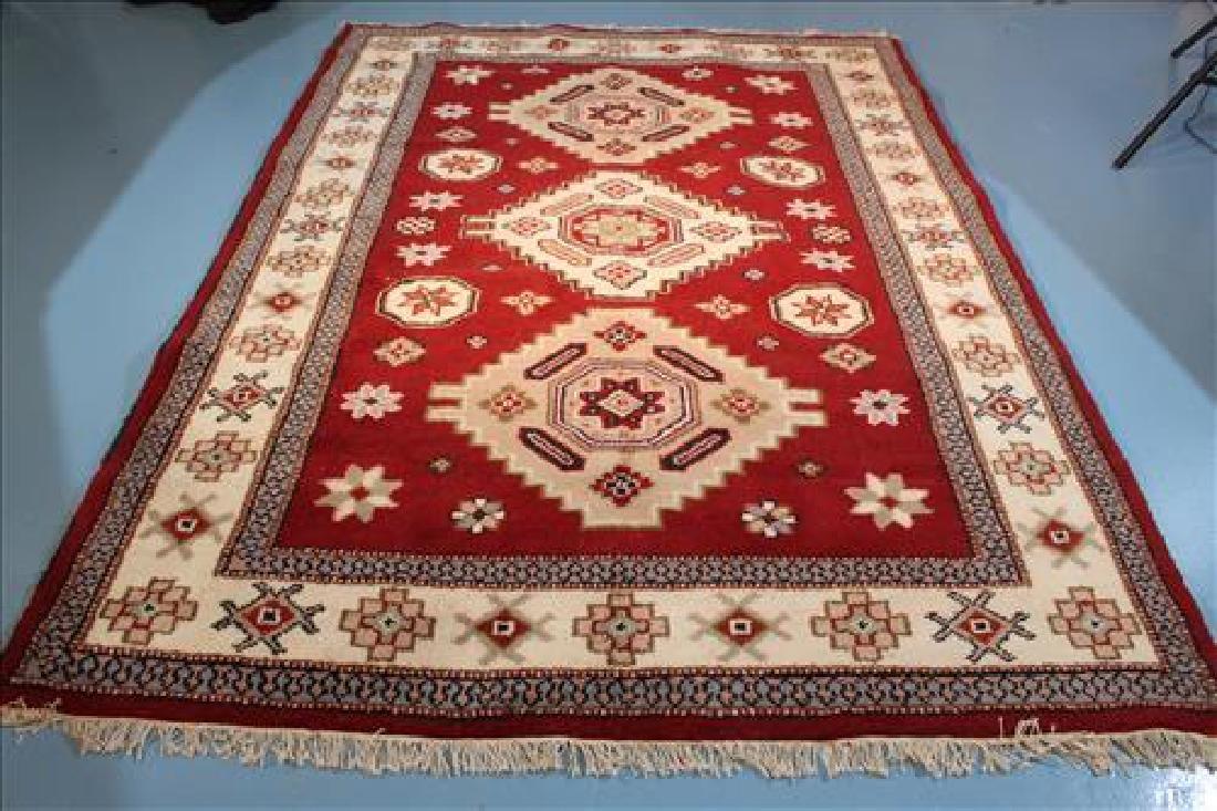 Handmade  wool rug, red and white, 5.11 x 8.1