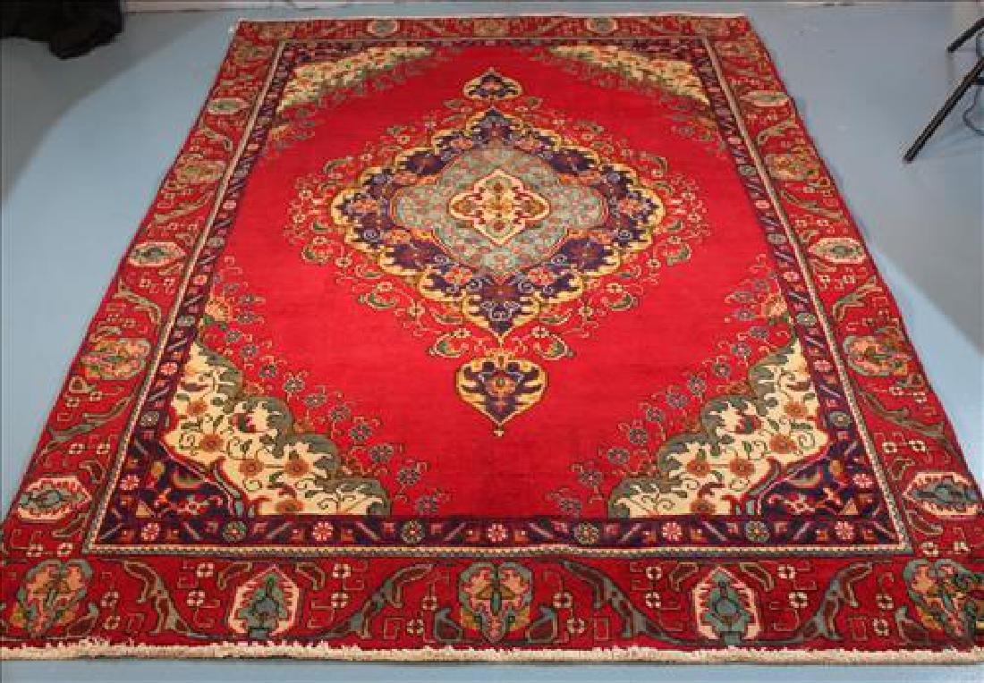 Red machine made rug, 5.11 x 8.8
