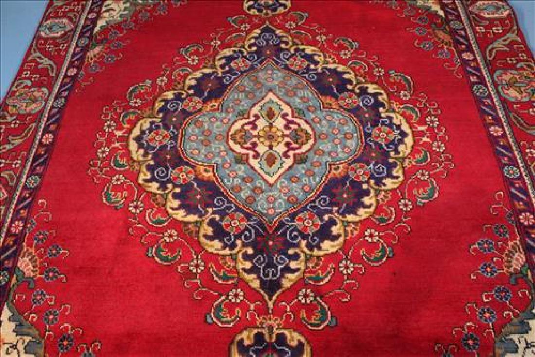 Red machine made rug, 5.11 x 8.8 - 2
