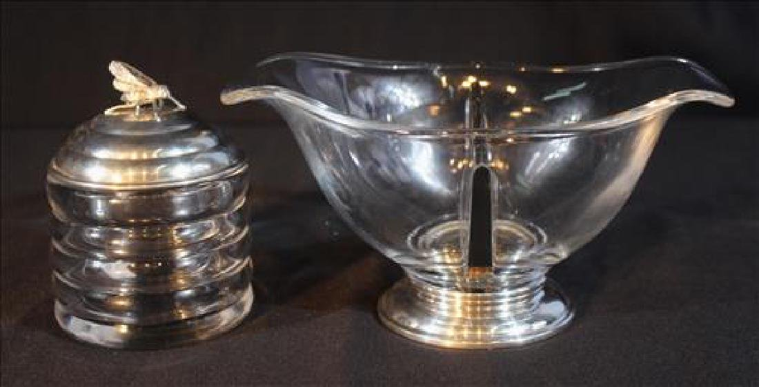 2 crystal serving pieces with silver attachments