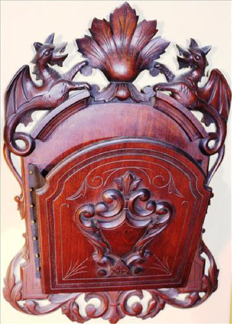 Walnut Victorian wall pocket with winged griffin crown