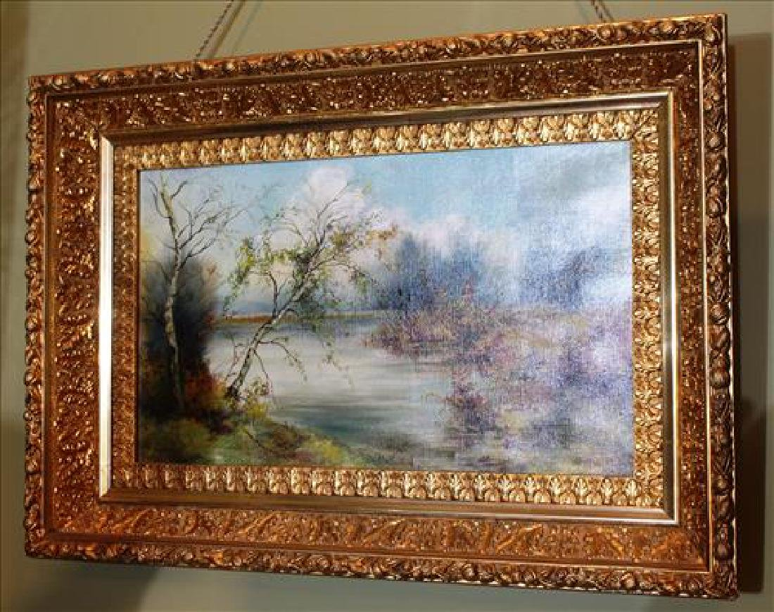 Oil on canvas of lake scene in great gold frame