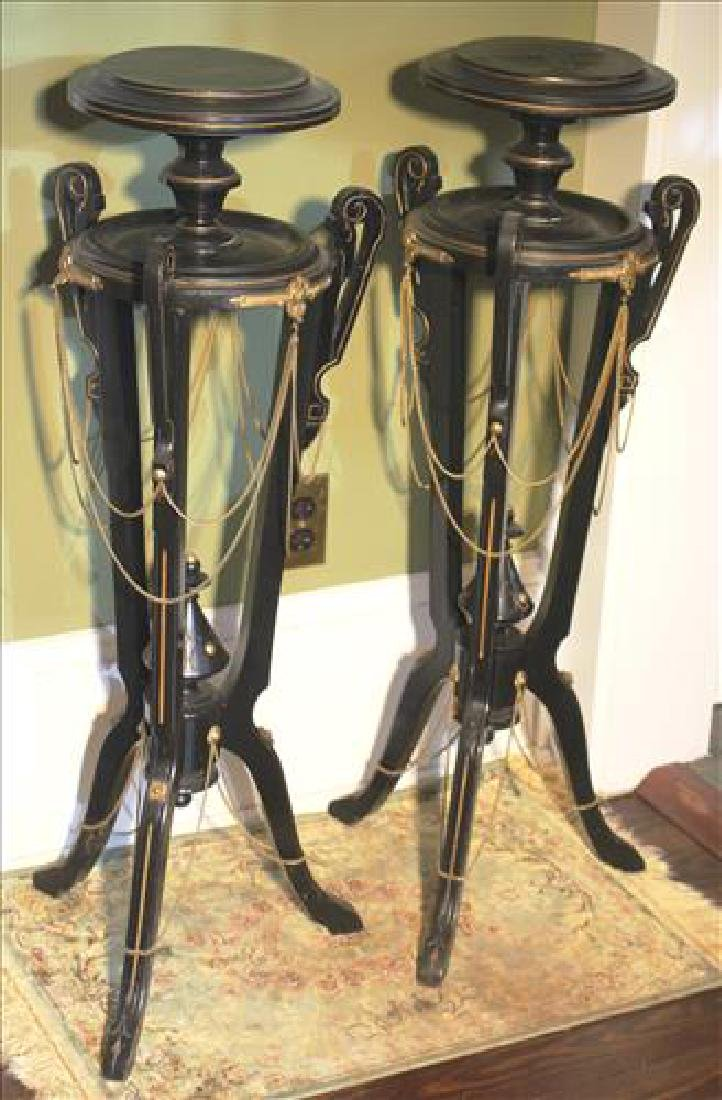 Matched pair of walnut Victorian pedestals with inlay