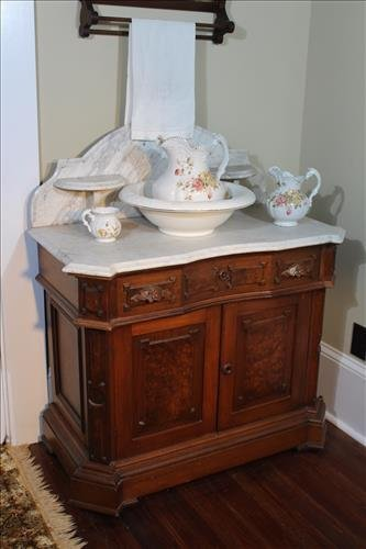 Walnut Victorian washstand with white marble top