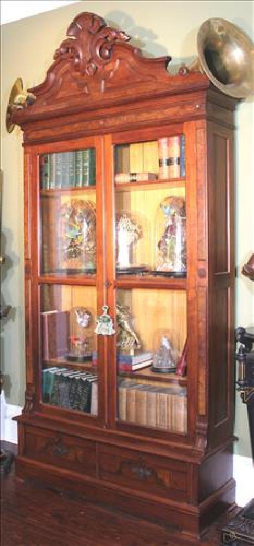 Tall walnut Victorian two door bookcase