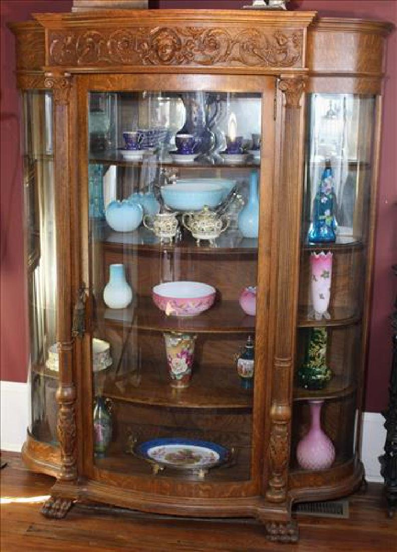 Large oak curved glass china cabinet, 70 in. T.