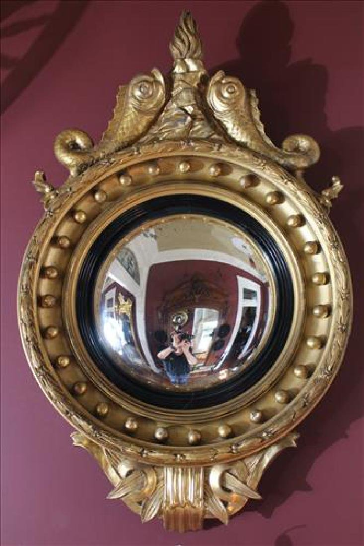 Gold gilt convex mirror with dolphins, 33 x 23