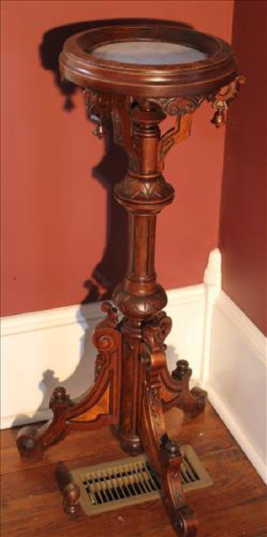 Walnut Victorian pedestal with inserted marble top