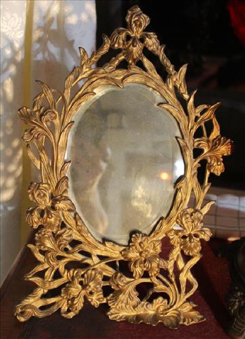 Victorian brass shaving mirror in ornate frame