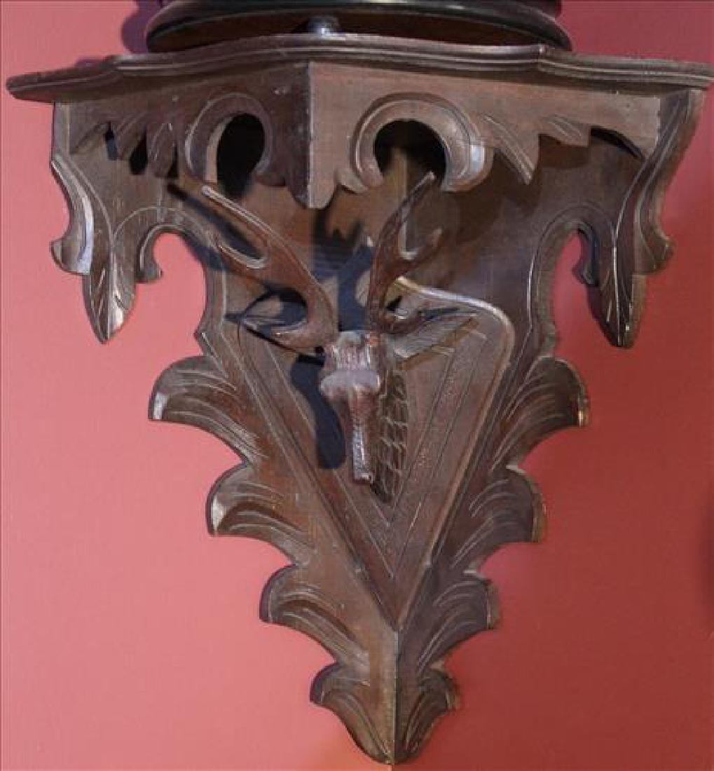 Walnut pierced carved corner what-not shelf