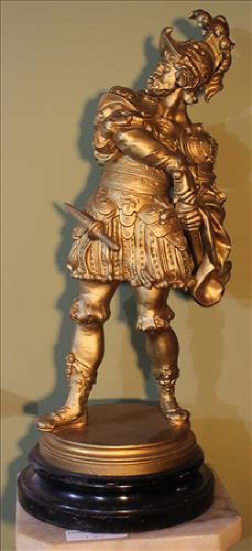 Metal statue of spanish soldier with wood base, signed