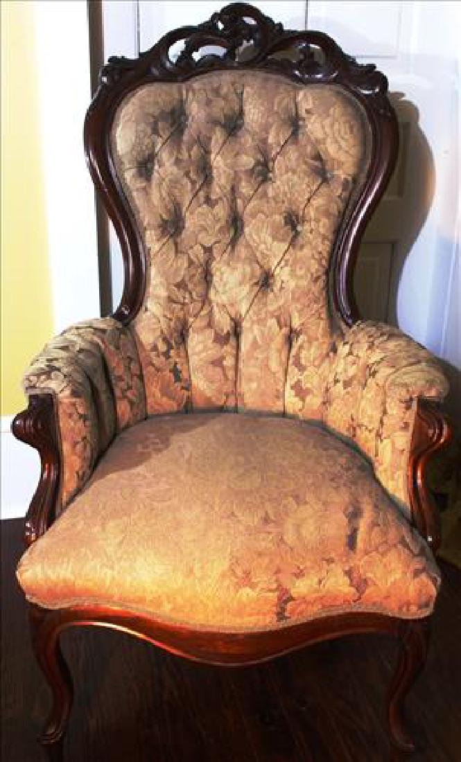 Walnut Victorian parlor arm chair with tan upholstery