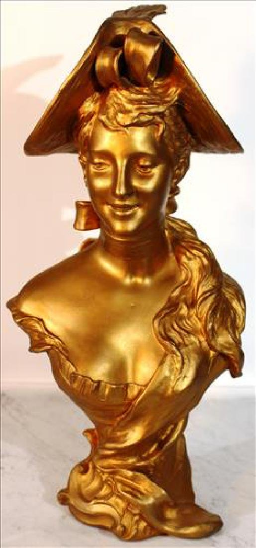 Pot metal bust of woman painted gold, 18 in tall,