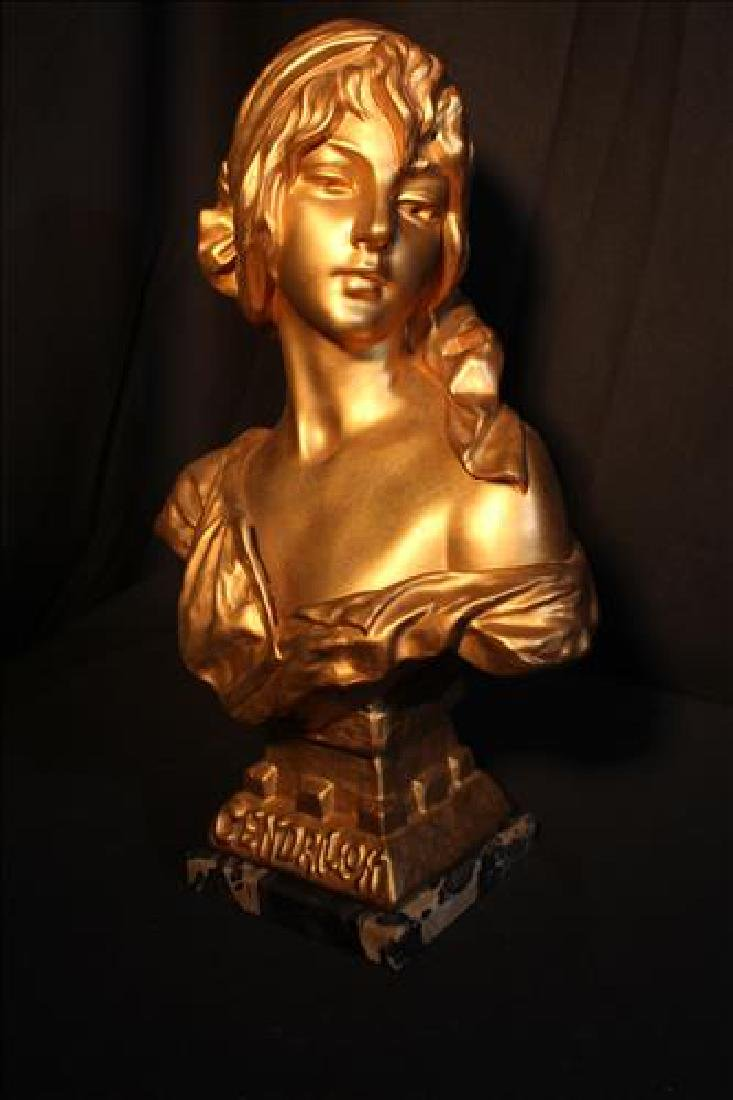Cast metal bust of woman painted gold, titled