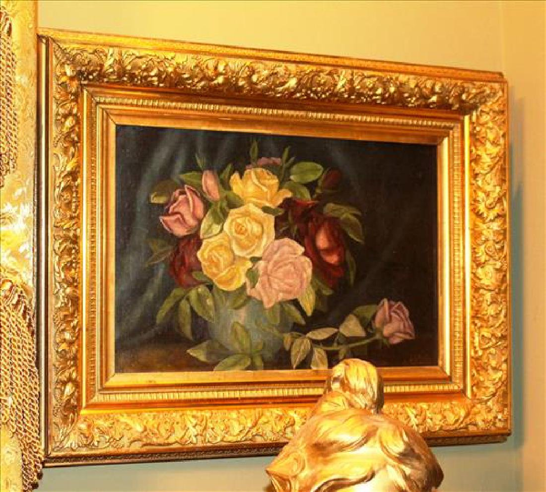 Oil on canvas of flowers in gold frame signed NDG,