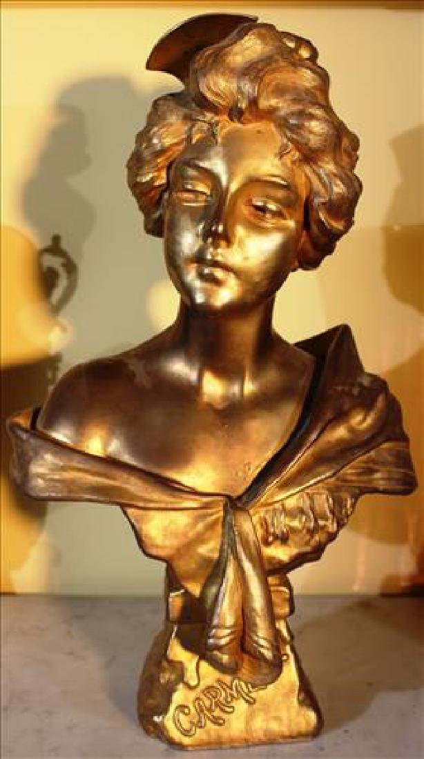 Metal bust of woman painted gold, 16T
