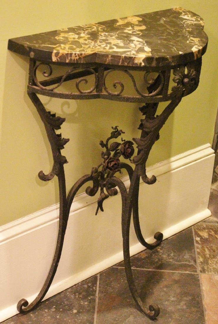 Wrought iron half moon table with black and gold marble