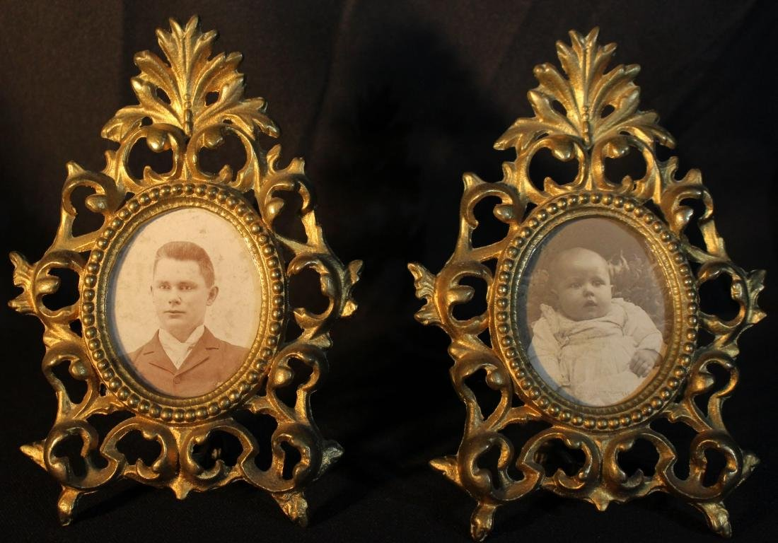 Small matched pair of brass Victorian frames with old