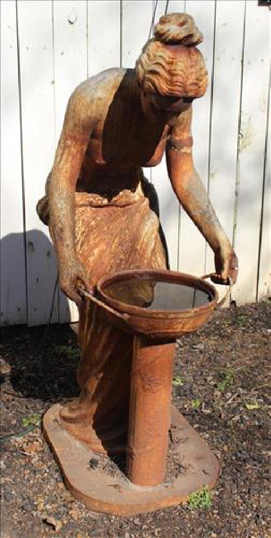 Cast iron statue of woman drinking from well, 54 in. T.