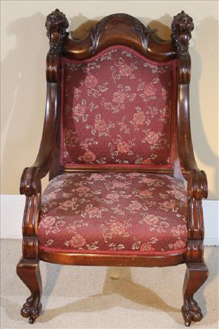 Mahogany arm chair with carved lion heads on arms