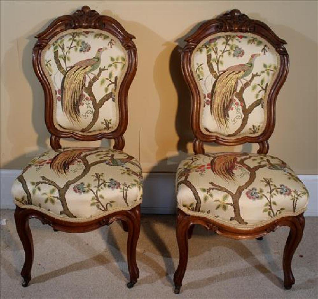 Pair of walnut Victorian side chairs with peacock