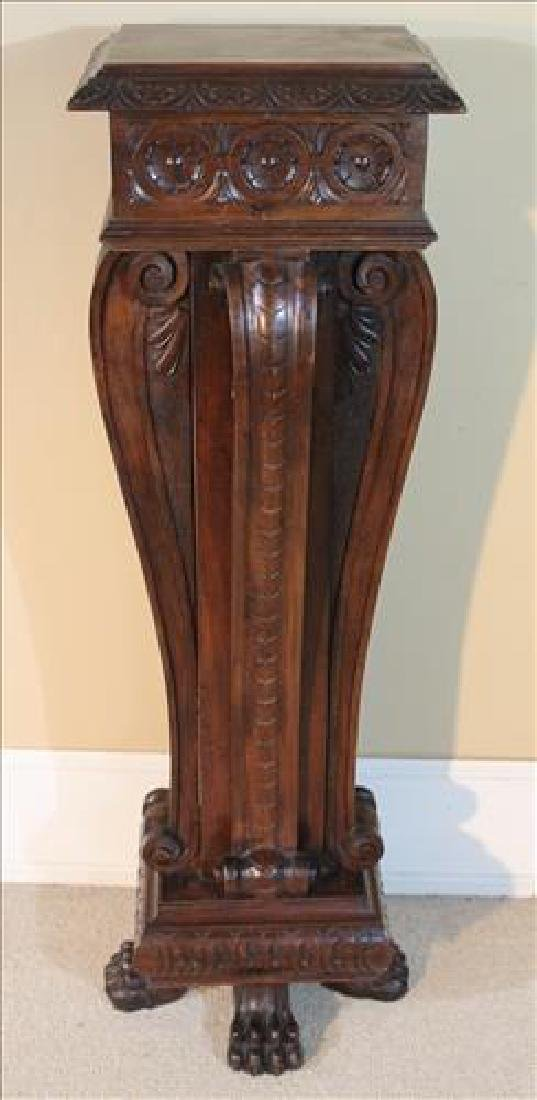 Walnut Victorian pedestal, heavily carved
