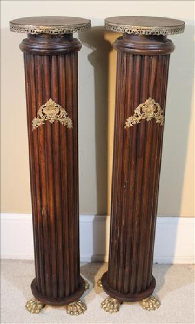 Pair column style pedestals with brass trim